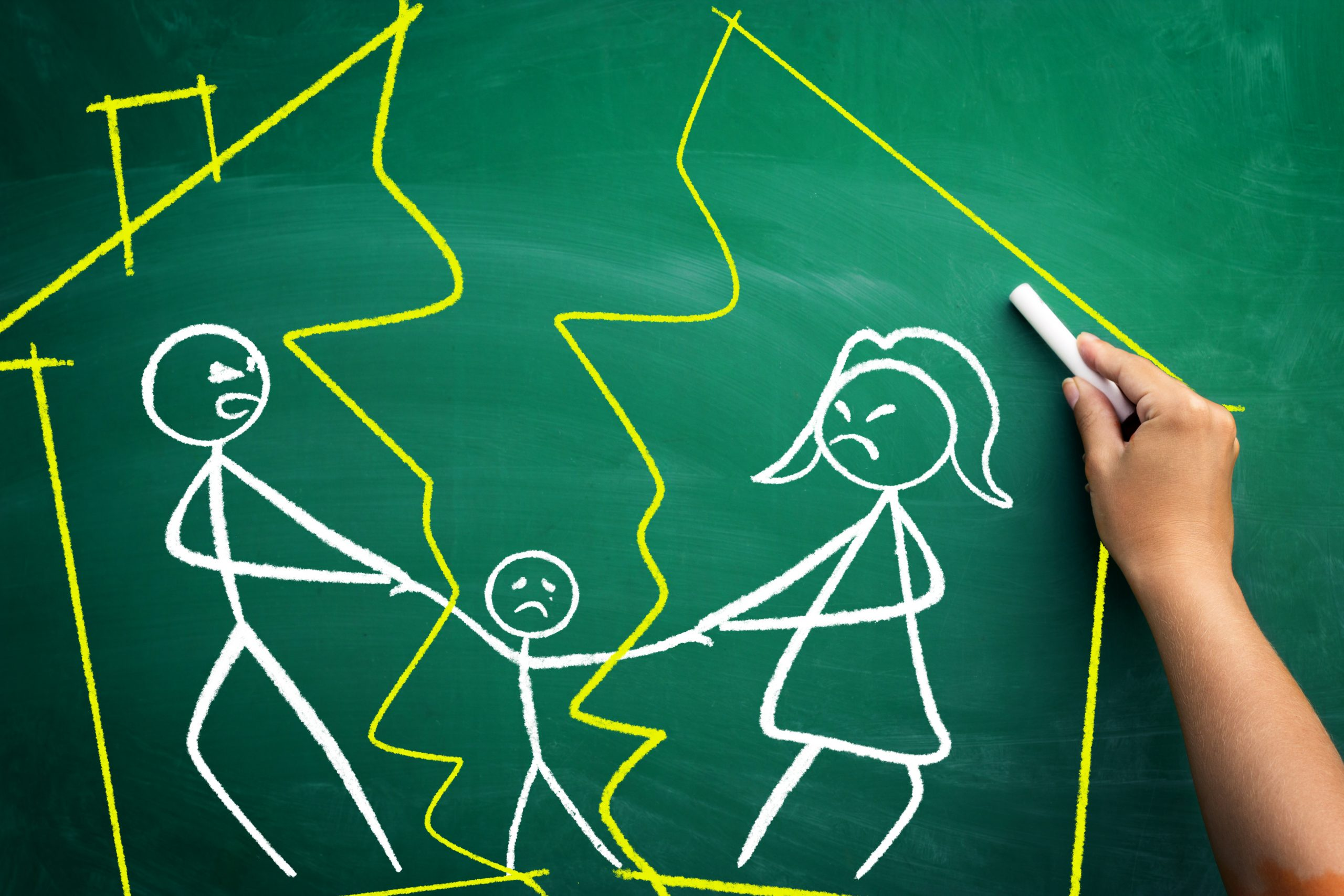 chalk board image of couple separating pulling a child between them
